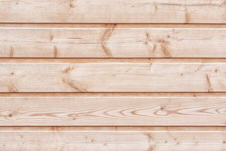 Wooden boards without processing. Fragment of a wooden horizontal fence. Background for the site and layouts.