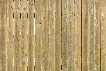 Wooden yellow background for sites and layouts. Fence made of even thin boards.