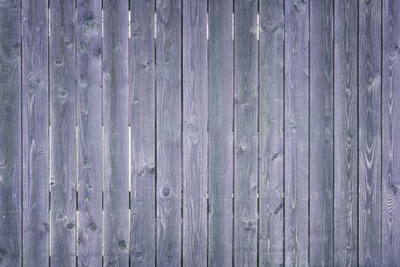 Wooden thin boards. Fragment of a dark blue vertical fence. Toned background for the site and layouts. 版權商用圖片