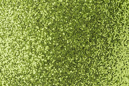 Shiny green background. Small sparkles close-up. The basis for sites and layouts.