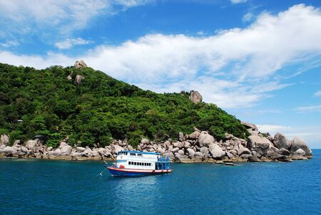 Boat in beautiful sea and tropical island with crystal clear water, Kho Nang Yuan, Suratthani, Thailand photo