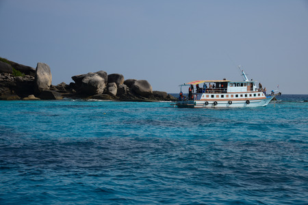 Boat on beautiful sea and tropical island with crystal clear water, Similan Island, Thailand