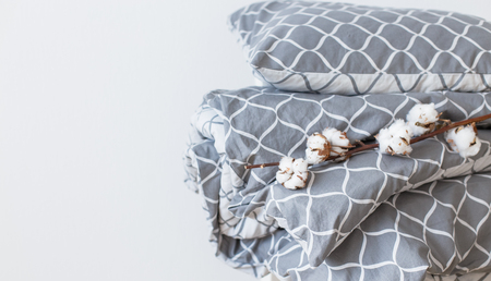 Modern grey bed linen pile, in trend, minimalism clean home concept