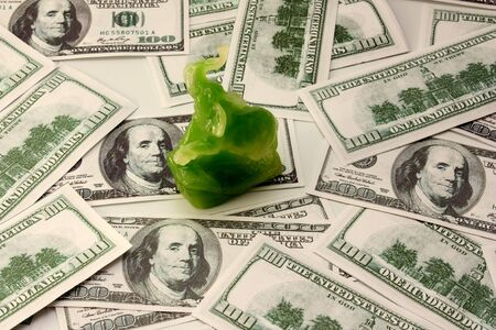hundreds: small green elephant on hundreds of dollars Stock Photo