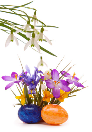 Colorful spring flowers and Easter eggs. photo