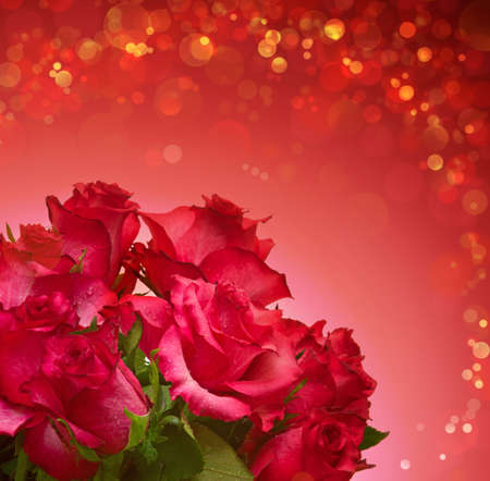 red rose bokeh: Red roses bouquet isolated on blurred background.Mothers day card.