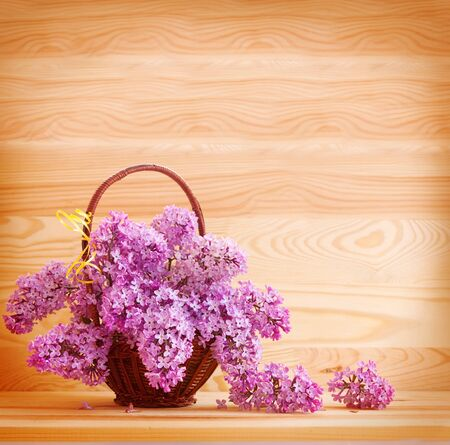 purple lilac: Purple lilac bouquet in basket.
