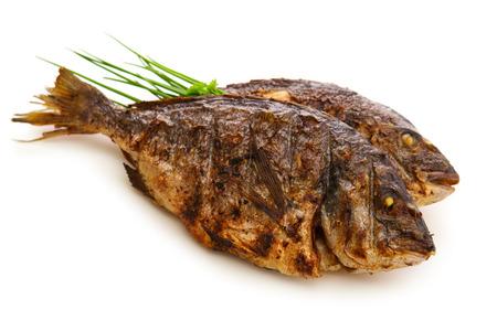 dorada: Closeups of two dorada fish with onion isolated on white background Stock Photo