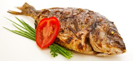 dorada: Closeups of dorada fish with vegetables and onion isolated on white