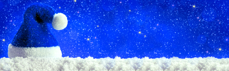 blue santa: Christmas  blau background with Christmas hat. Blue santa hat. Stock Photo