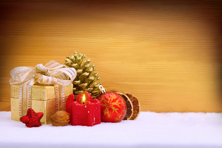 winter celebration: Christmas background with red advent candle. Christmas decoration.