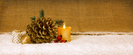 fir cones: Avent  candle  and  golden fir cones decoration.Christmas decoration and white snow.