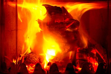 burning fireplace: Flames of fire in a fireplace.Burning Fireplace.Macro Stock Photo