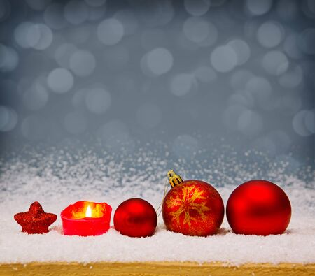 Red christmas balls isolated .Christmas decoration and snow background.Red Christmas decoration isolated on grey background. Christmas decoration and advent candle.White snow.