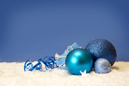 blue christmas background: Blue christmas balls isolated .Christmas decoration and snow background.