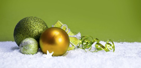 Green christmas balls isolated .Christmas decoration and snow background.