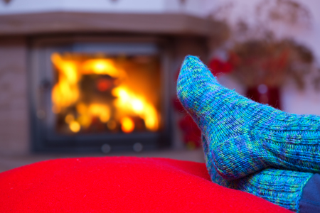 woman relax: Relaxing at the fireplace on winter evening. Stock Photo