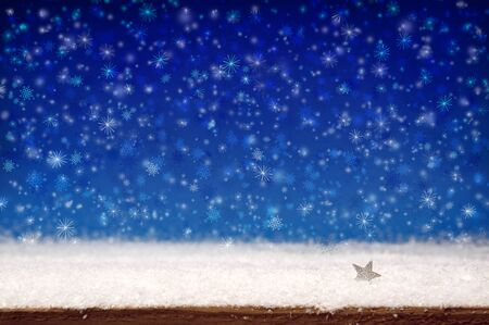 Winter christmas background. White snow and blue bokeh background.Christmas background.