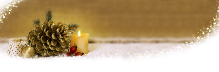 decoration: Avent  candle  and  golden fir cones decoration.Christmas decoration and white snow.