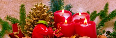 fir cones: Christmas decoration with fir cones and candle for advent.Four red candles with christmas decoration. Stock Photo