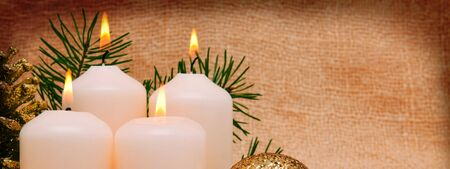 candle: Christmas decoration  and candle for advent.Four  white  candles . Stock Photo