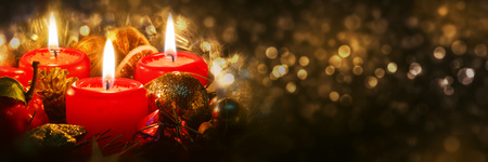 christmas atmosphere: Advent candles with christmas decoration in atmospheric light.