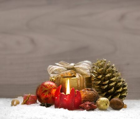 flamme: Christmas gift box with decoration isolated on grey background.Christmas gift box with  decorations and red candle.