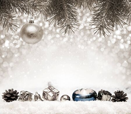december background: Silver  Christmas Background.Abstract silver bokeh background of christmas light. White snow and christmas decoration.