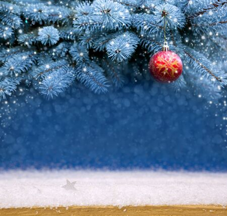 red christmas ball: Red Christmas Ball on the Fir Branch Covered with Snow. Beautiful Christmas balls on fir branches covered with snow. Christmas Background and snow.
