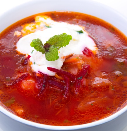 Ukrainian red soup borscht with sour cream, top view, isolated. Фото со стока