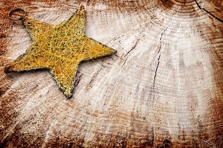 Kerstmis rustieke achtergrond en ster. Plankhout en vrije tekstruimte. Stockfoto