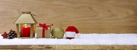 flamme: White snow with Christmas hat isolated on wood background .Christmas background with lantern and snow.