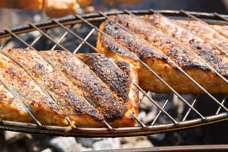 Grilled salmon steaks on the grill.Two fresh crispy grilled salmon.