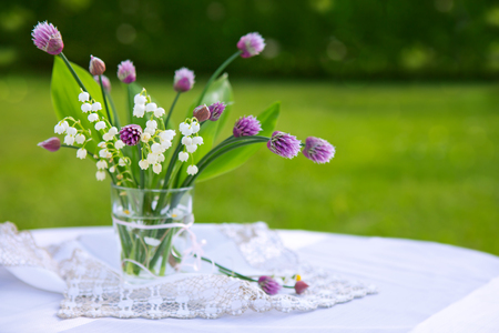 mayflower: Lily of the valley bouquet in glas vase. Stock Photo