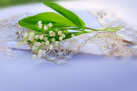 mayflower: Lily of the valley bouquet on the table.
