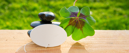 Black spa stones and four leaf clover .