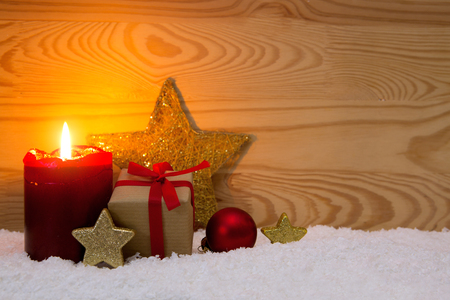 Christmas gift box and red Advent candle. Stock Photo