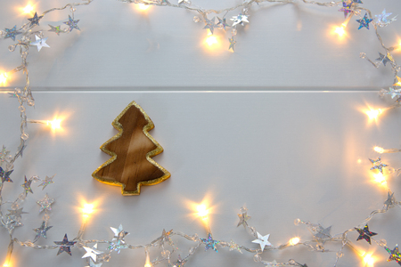Christmas fir tree with garland isolated. Stock Photo