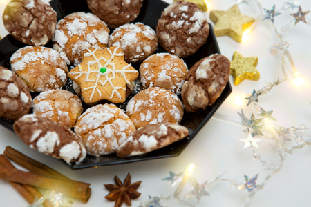 Chocolate Christmas Cookies with decoration isolated. Stock Photo