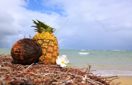 Tropical pineapple cocktail drink at the caribbean beach Stock Photo