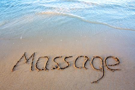 Word Massage written on the sand near the sea.Massage concept written on sand. 스톡 콘텐츠 - 96373798