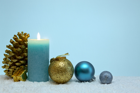 Blue Advent candle and decoration. Christmas background.