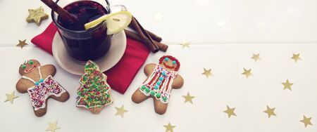 Male and Female Christmas Cookies with garland and mulled wine.