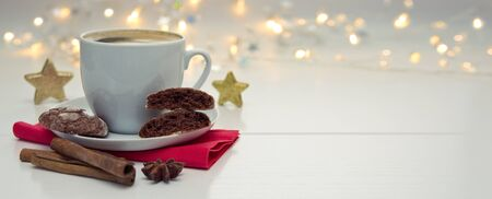 Christmas chocolate Cookies with garland and coffee cup.