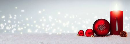 Christmas background with first Advent candle and red bauble . Stock fotó - 133570223
