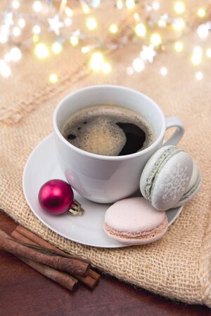 Colorful macaroons and coffee cup. Christmas card.