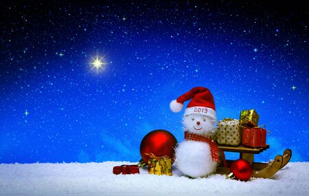 Christmas snowman with santa claus hat isolated on star sky background.