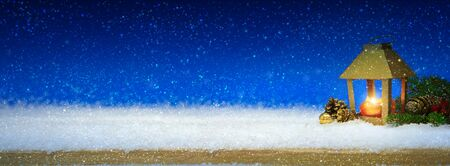 Christmas lantern on white snow.Winter blue background. Stok Fotoğraf