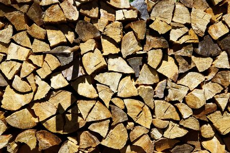 Background or texture symmetric with pieces of wood for stove fireplace and ax. Banco de Imagens