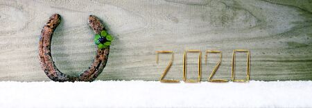 Four leaved clover and New Year 2020 background.
